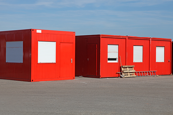 2 red mobile office containers